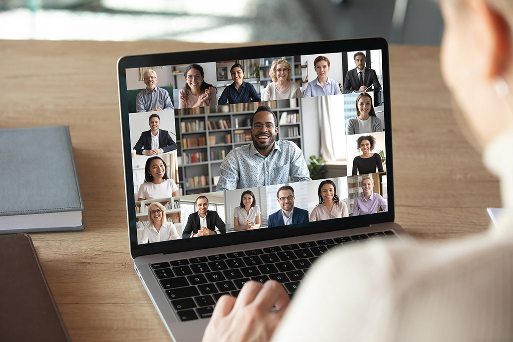 an image of a person on a conference video call on their laptop